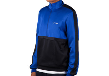 dime-track-jacket-quarter-zip-blue-black-stripe-2-model-angle